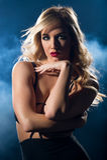 Sensual woman looking at camera in a night dress Stock Image