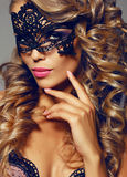 Sensual woman with luxurios blond hair with mask on face Stock Image