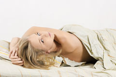 Sensual woman lying in bed Royalty Free Stock Images