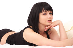 Sensual woman lying in the bed Royalty Free Stock Image