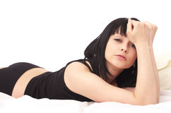 Sensual woman lying in the bed Royalty Free Stock Images