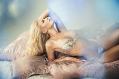 Sensual woman lying in a bed Royalty Free Stock Photo