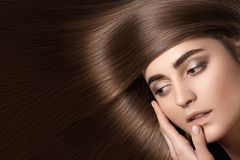 Sensual woman model with straight dark hair. Shiny long health hairstyle Stock Photography