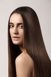 Sensual woman model with straight dark hair. Shiny long health hairstyle stock photos