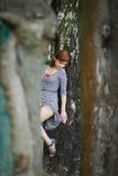 Sensual woman near a tree. Young woman near the tree bares her leg Stock Photos
