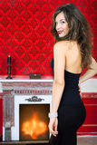 Sensual woman next to a fireplace in vintage room Royalty Free Stock Photo