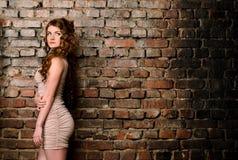 Sensual woman on old brick wall background Stock Photo