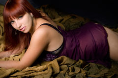 Sensual woman over folded backdrop Royalty Free Stock Photography