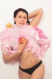 Sensual woman in panties with apple Stock Images