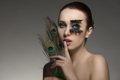 Sensual woman with peacock feathers Stock Photos