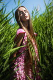 Sensual woman in pink dress in grass Royalty Free Stock Photography