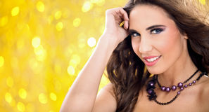 Sensual woman posing. Young sensual woman posing over yellow background Stock Images