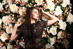 Sensual woman posing on flower background. Beauty and make up. Sensuality Royalty Free Stock Photo