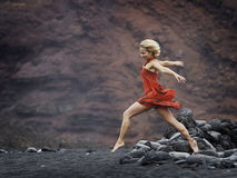 Sensual woman posing on volcanic beach in summer. Young sensual woman posing on volcanic beach in summer Stock Photos