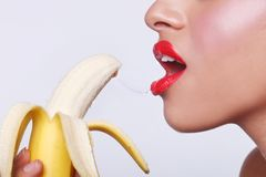 Sensual Woman Preparing to Eat a Banana Royalty Free Stock Photography