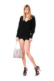 Sensual woman with the purse. Sensual blonde woman with the white purse royalty free stock images