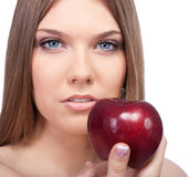 Sensual woman with red apple Royalty Free Stock Photography