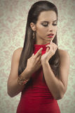 Sensual woman with red dress Stock Photos