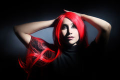 Sensual woman with red hair. Portrait. Elegant fashion model in wig redhead hairstyle Stock Photography