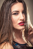 Sensual woman with red lips closeup. On golden background Royalty Free Stock Image