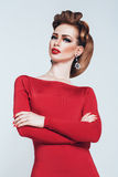 Sensual woman with red lips in red dress. In studio Royalty Free Stock Photo