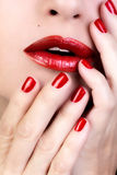 Sensual Woman Red Lips. Red Nail Polish Royalty Free Stock Images
