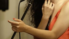 Sensual woman with red lips sings in microphone stock footage