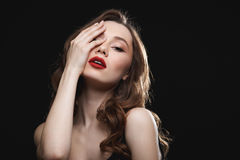 Sensual woman with red lips touching her face. Sensual gorgeous young woman with red lips touching her face stock photography