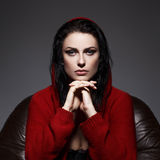 Sensual woman in red sweater with hood portrait stock images