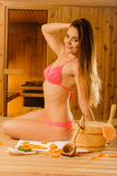 Sensual woman relaxing in sauna. Spa wellbeing. Royalty Free Stock Photography