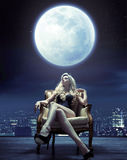 Sensual woman relaxing under the moon light Stock Image