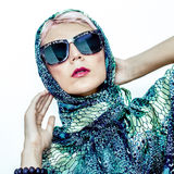 Sensual woman in a scarf and glasses Royalty Free Stock Photo