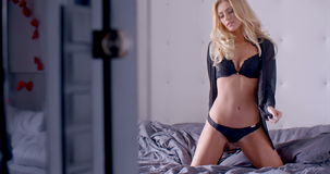Sensual Woman On Sofa Looking At Camera Stock Video - Video of ... a216456ea