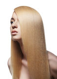 Sensual woman with shiny straight long blond hair. Well-being & spa. Sensual woman model with shiny straight long blond hair. Health, beauty, wellness, haircare Royalty Free Stock Photos