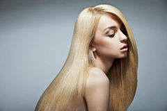 Sensual woman with shiny straight long blond hair. Well-being & spa. Sensual woman model with shiny straight long blond hair. Health, beauty, wellness, haircare Royalty Free Stock Image