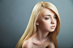 Sensual woman with shiny straight long blond hair. Well-being & spa. Sensual woman model with shiny straight long blond hair. Health, beauty, wellness, haircare Stock Image