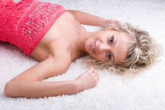 Lying woman in short dress Stock Images