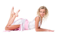 Lying woman in short dress Royalty Free Stock Images
