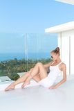 Sensual woman sitting at balcony with a view Stock Photos