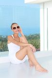 Sensual woman sitting at balcony with a view Royalty Free Stock Photo