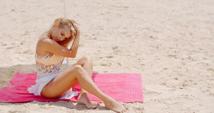 Sensual Woman Sitting on the Mat at the Beach stock video footage