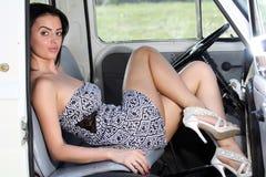 Sensual woman sitting retro car Royalty Free Stock Image