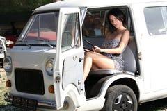 Sensual woman sitting retro car Stock Image