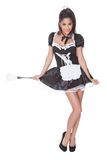 Sensual woman in skimpy maids uniform. Beautiful sensual woman posing in a skimpy maids uniform with miniskirt on a white background Stock Photos