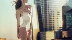 Sensual woman with the skyscrapers in the background Royalty Free Stock Images