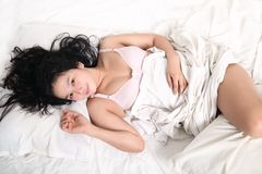 Sensual woman sleeping on bed Stock Photos