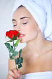 Sensual woman smelling a red rose Stock Images