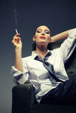 Sensual woman smoking a cigarette Royalty Free Stock Photography