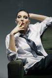 Sensual woman smoking a cigarette Stock Image