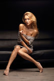 Sensual woman on the sofa Stock Image